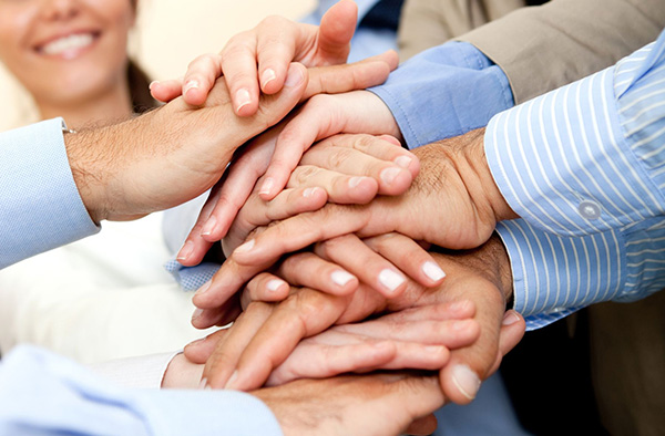 Business group with hands together