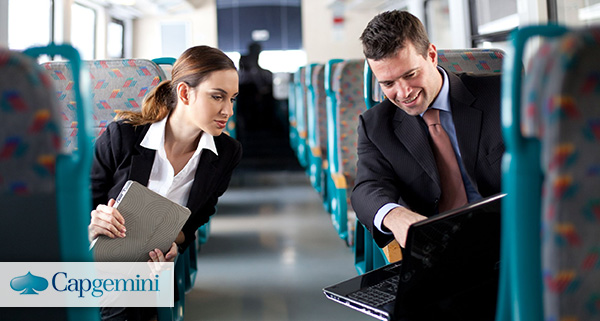 Business people comparing notes on the train