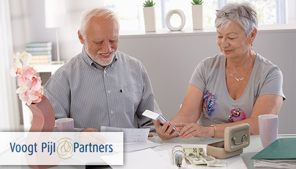Happy senior couple calculating family budget at home. - Voogt Pijl & Partners